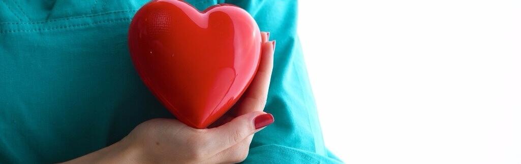 Scrubs girl holding heart – banner size